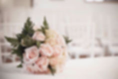 bouquet-of-roses-on-table-at-wedding.jpg