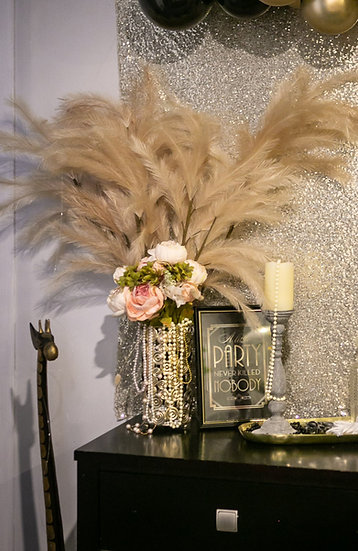Gold metal feather centerpiece
