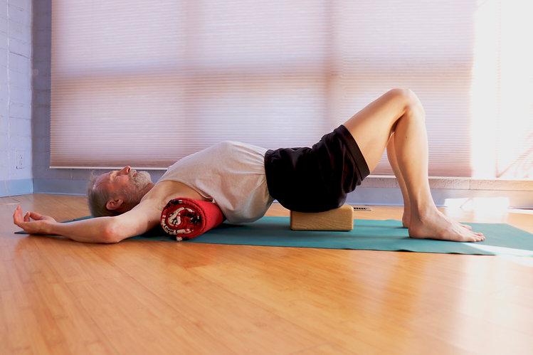 Man Stretching | Yoga Block \ High Desert Yoga | Albuquerque