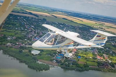 Самолет Х-32 Бекас в небе над Краснодаром, парный полет на самолетах Х-32 Бекас, прогулочные полеты на самолетах Х-32, полеты на самолетах в Краснодаре