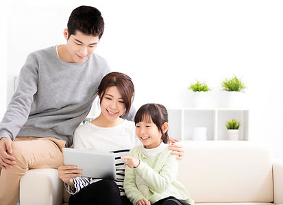 Happy-Attractive-Young--Family-watching-the-tablet-513591154_2035x1478.jpeg