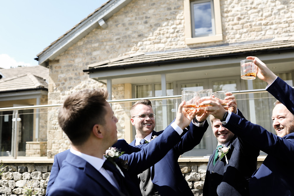 Liam and his groomsmen having a whiskey before the ceremony. In Grassington
