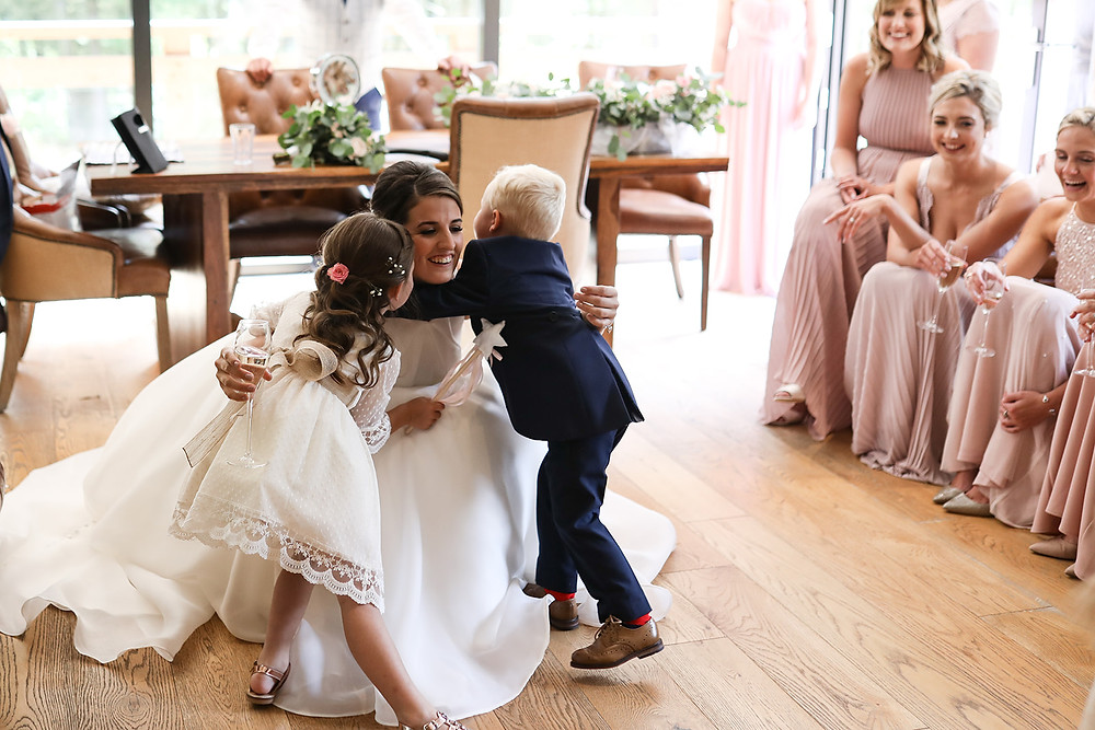 Bride with flower girl and pageboy.