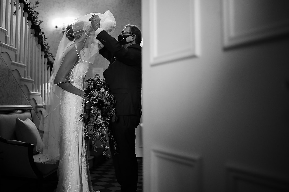 A moment of emotion, as the father of the bride put her veil over her face.
