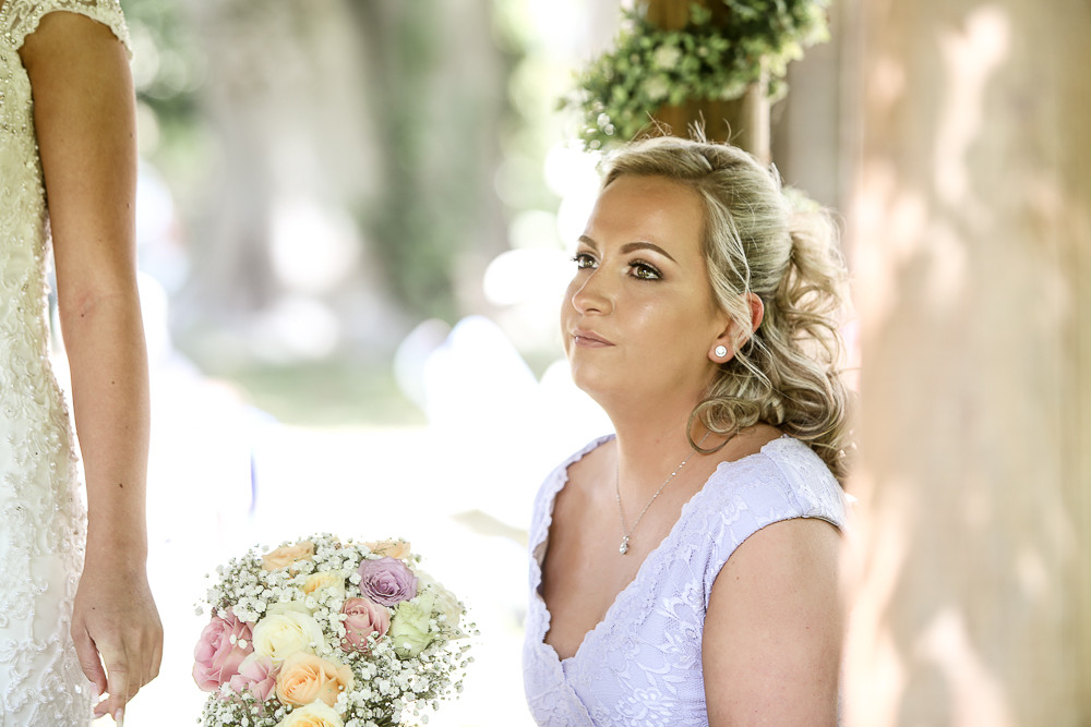 Beth watching her sister say I do.
