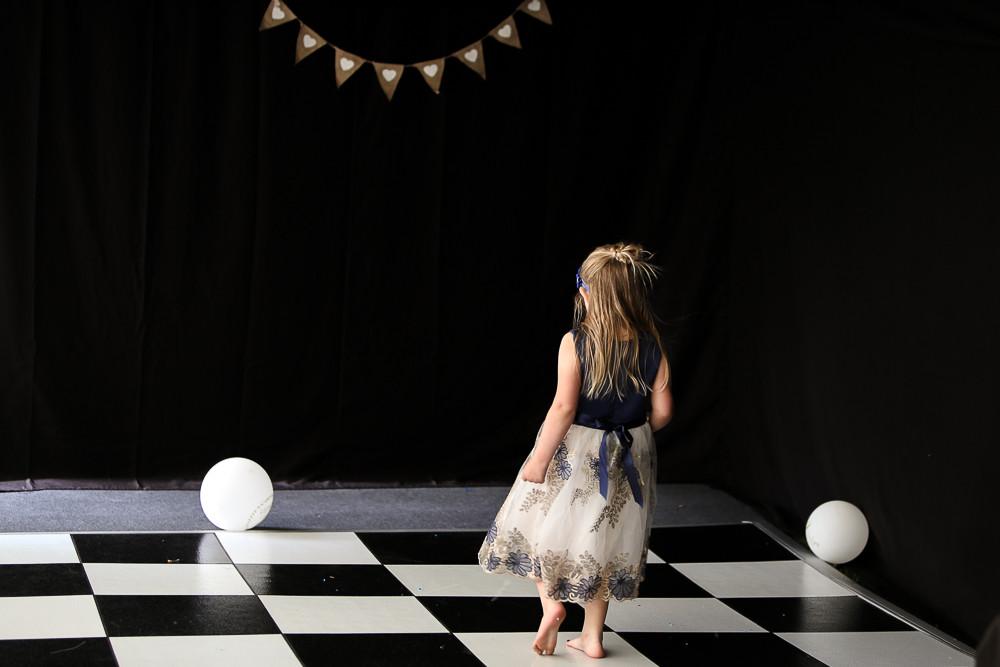 Flower girl on the dance floor.