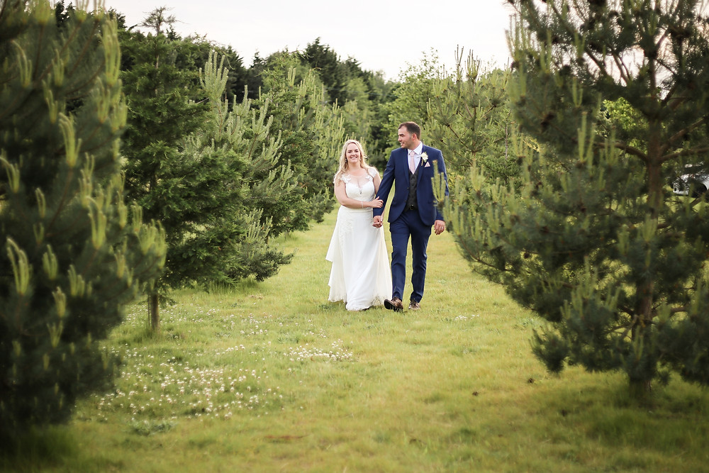 Katie and Richard wandering through pine trees in Allerthorpe