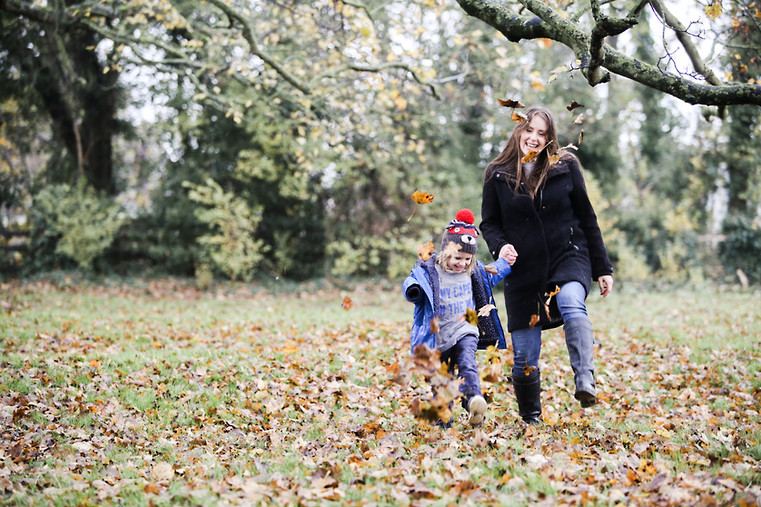 Fun in the auntumn leaves at Orchard Fields in Malton.