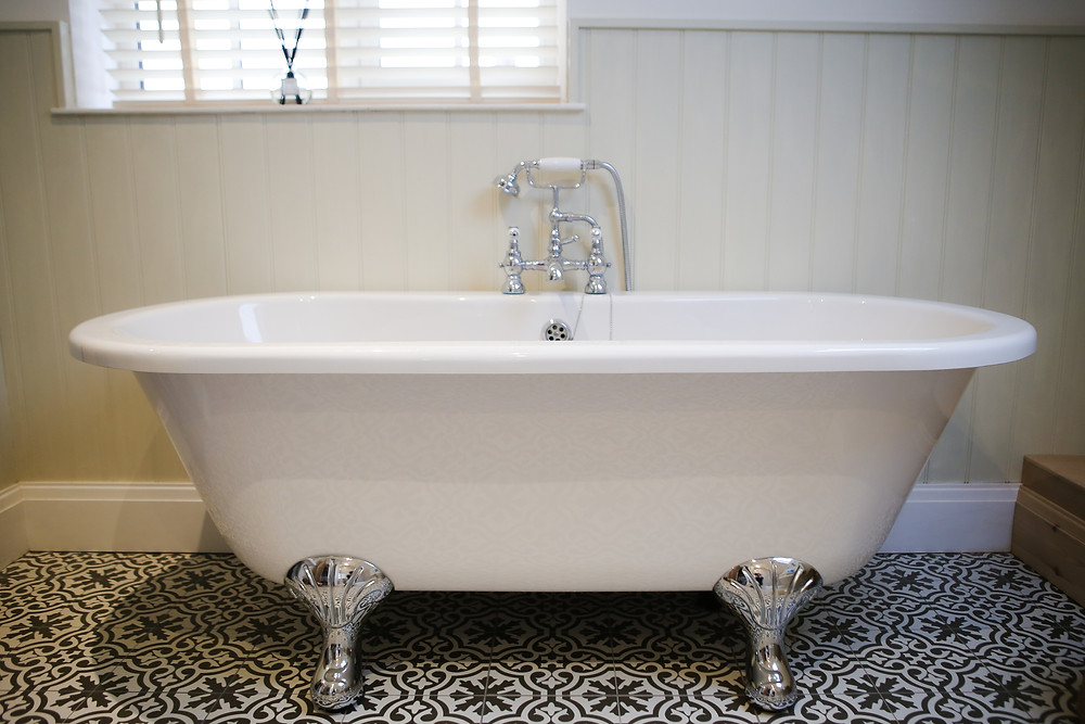 Traditional bathroom with victorian flooring.