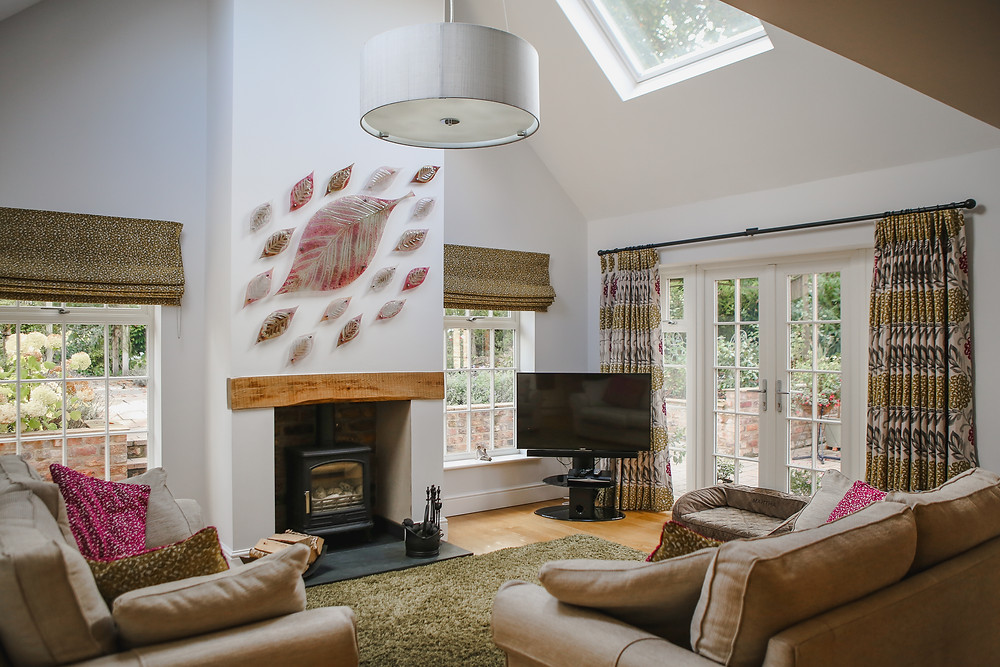 Tastefully decorated living area with log burner.