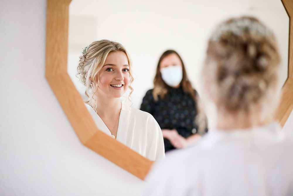 Bride checking our her makeup
