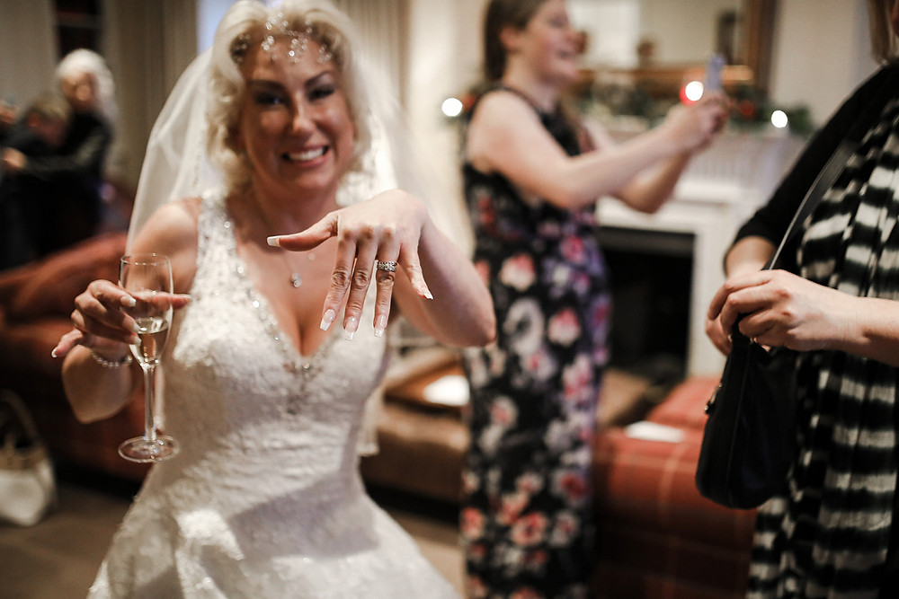 The bride showing off her ring.