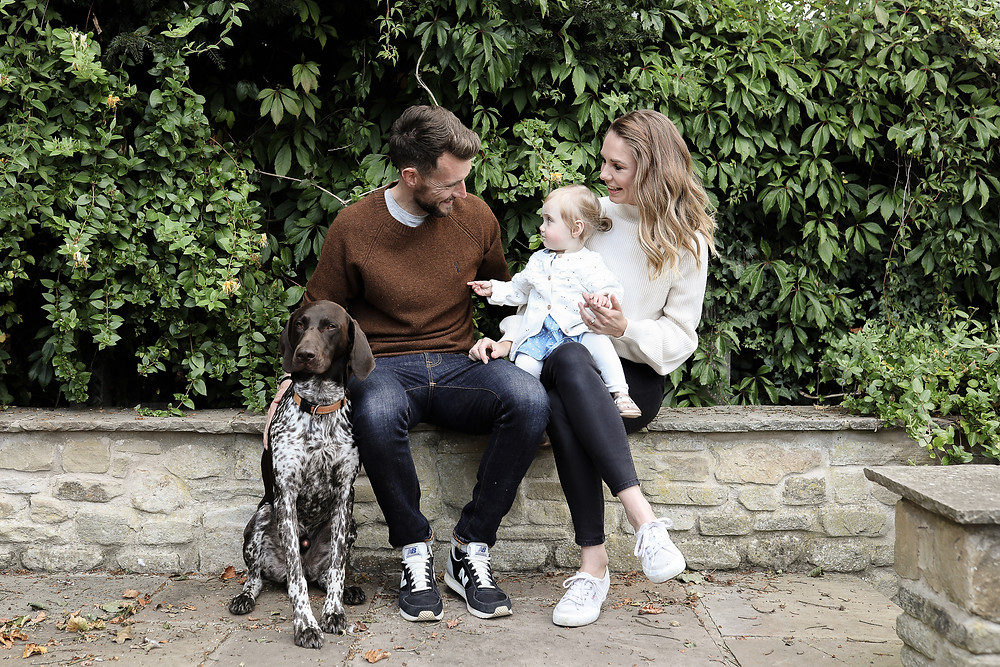 A family with their German Pointer