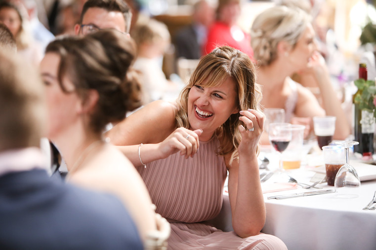 Guest laughing at the speeches, at Deepdale Farm.