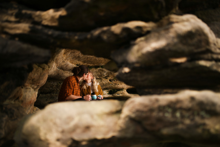 Couple in the cave sharing coffee