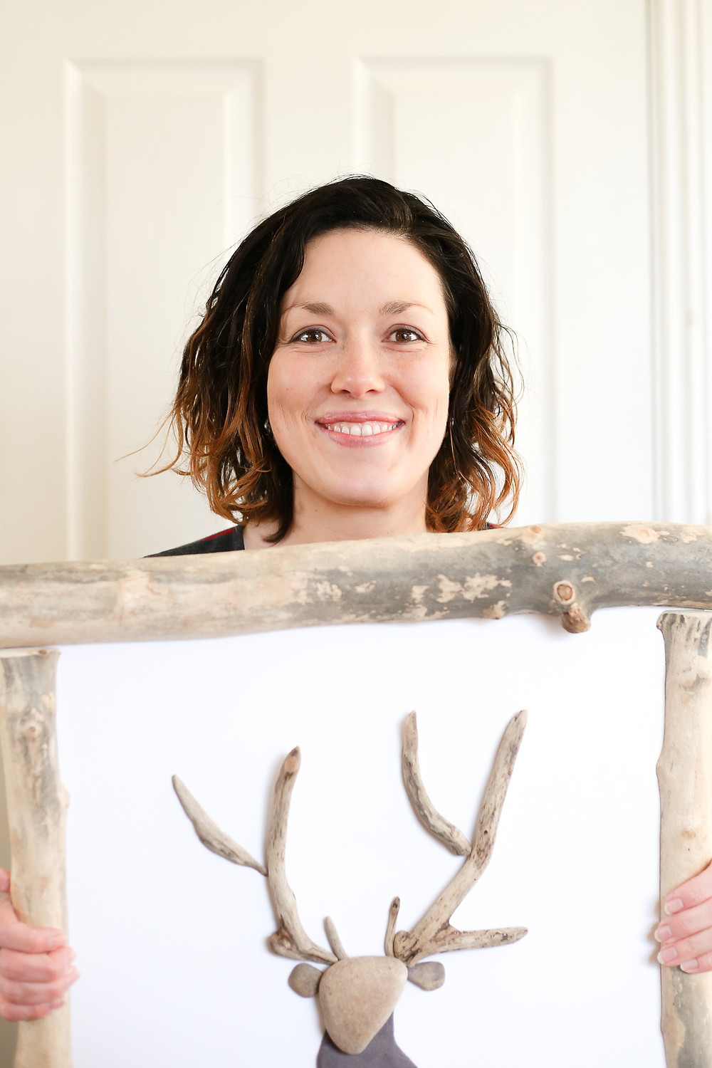 Artist with stag art work.