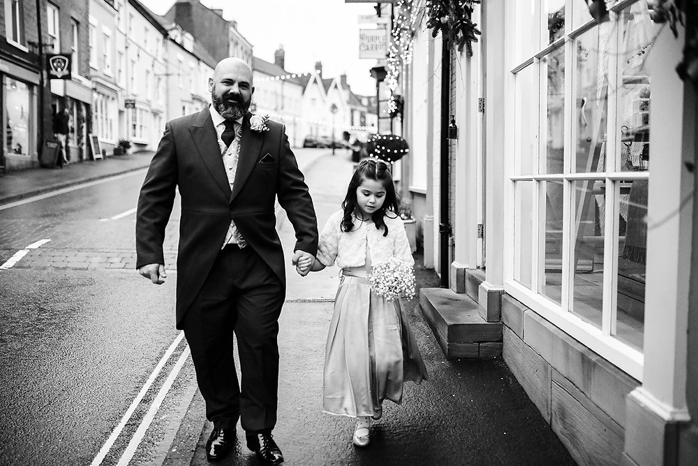 Father and Daughter walking to the get some photos