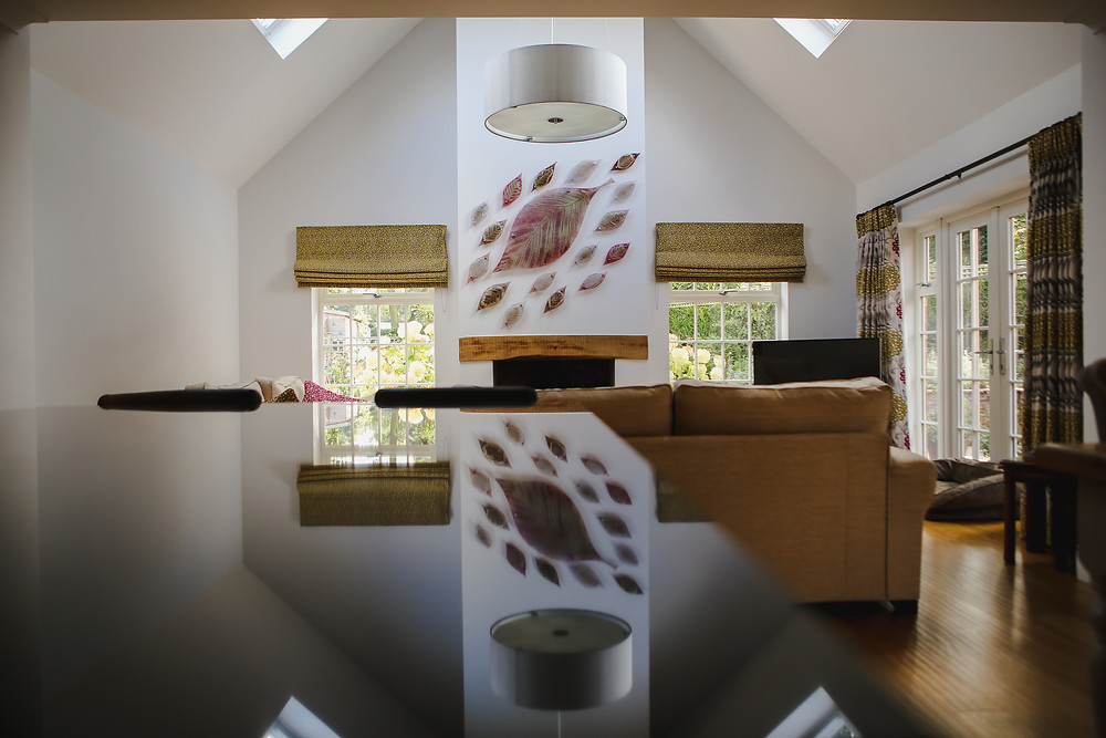 Vaulted room with natural light, reflection on surface.