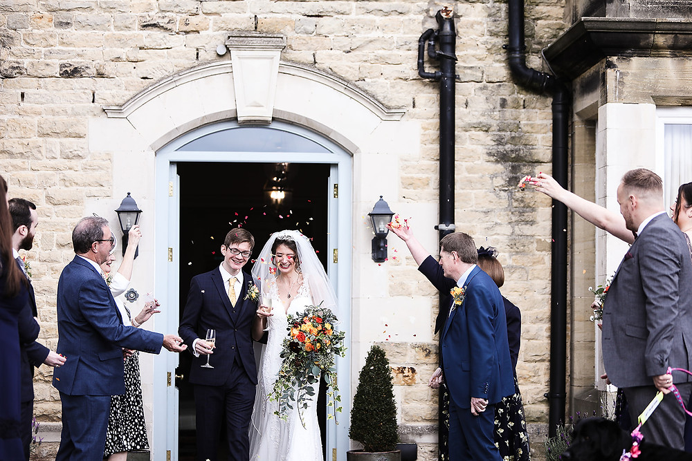 Sprinkling the couple with confetti