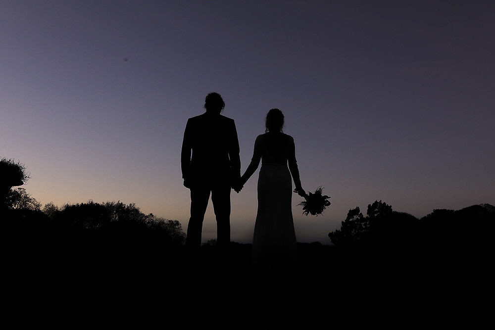 A silhouette of the couple.