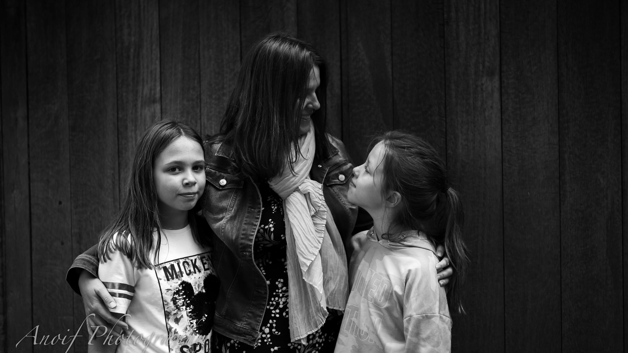 Family in front of wooden doors.