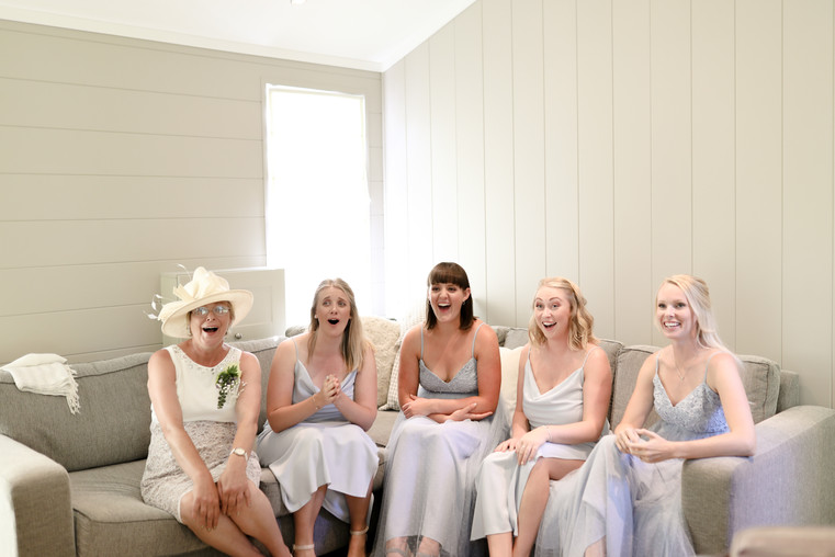 Revealing the dress to her bridesmaids, I love their reactions!