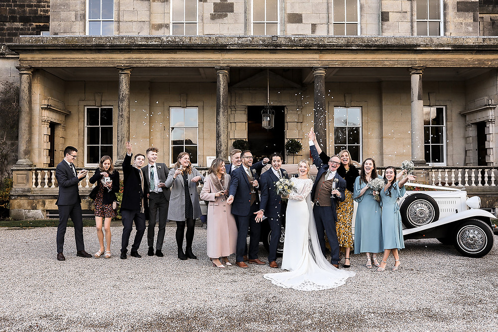 Fun shots, with the whole wedding party as they unexpectedly threw confetti over Hannah and George.