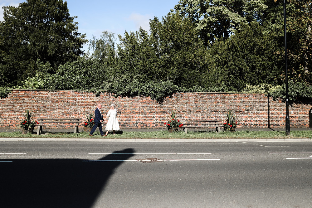 Bride and Groom hand in hand, York
