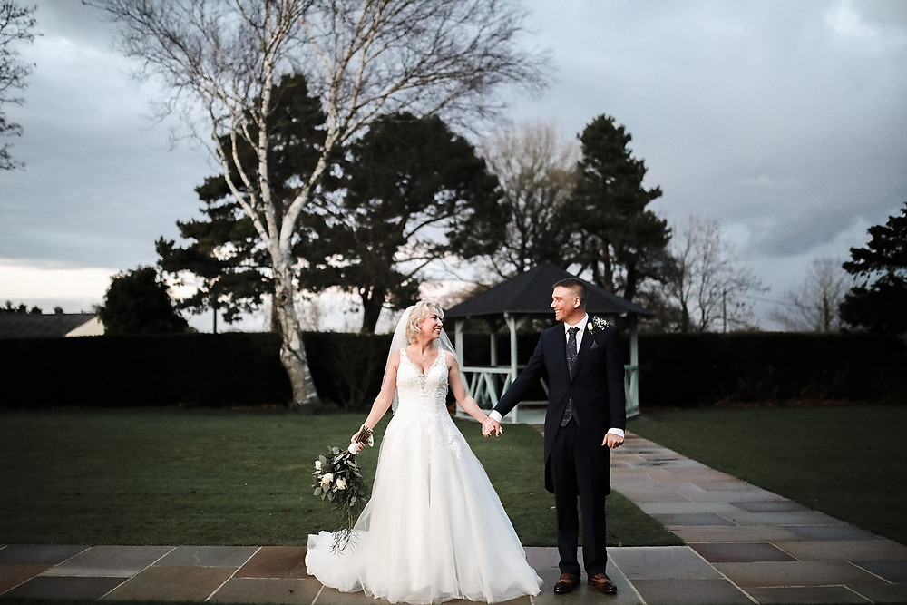 The couple share a walk together in the gardens at Burrythorpe House