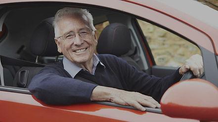 smiling-senior-man-driving-car_edited.jp