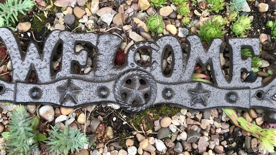 Rustic iron welcome sign