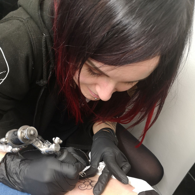 Laura creating another beautiful tattoo