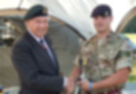 Chris Tyrrell of the Royal Engineers picks up The Lee Rigby Cup on The Forces March