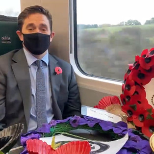 Johnny Mercer MP supporting Poppies To Paddingotn with a The Veterans Charity wreath