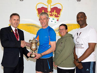 Members of the team receiving The Military Challenge Cup for The Forces March