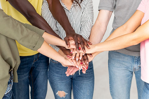 group-friends-with-hands-top-each-other.