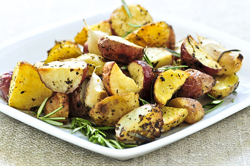 Herb roasted potatoes served on a plate.