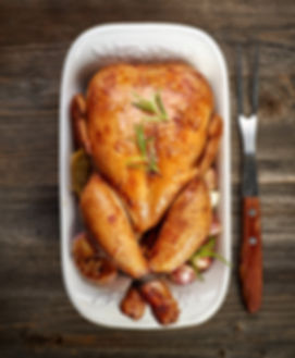 roasted chicken with vegetables on woode