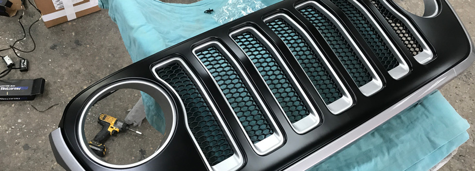 White and Black Jeep Grill