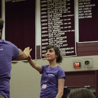 About to punch Douglas Seldin in the face, from a safe distance, as a model for 200 high school students to follow.