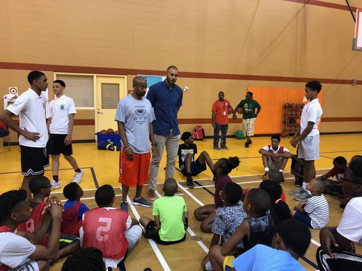 Jordan talking to the youth at the Back-to-School celebration