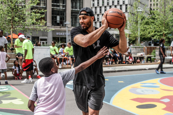 Jordan Morgan playing one-on-one with a camper