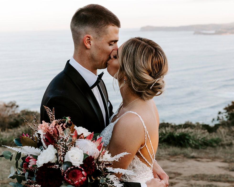 Bride & groom portrait over looking water on Central Coast
