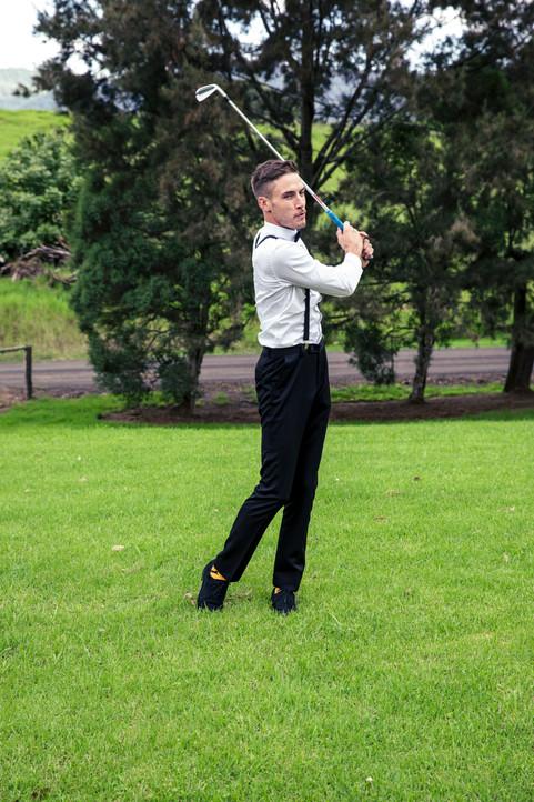 Groom playing gold at Kangaroo Valley Wedding