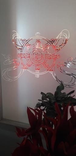 kolo dhramy, jeden z osmi šťastných symbolů na průhledu do gompy