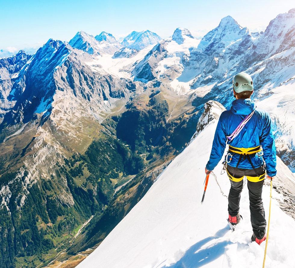 Man on top of mountain.jpg