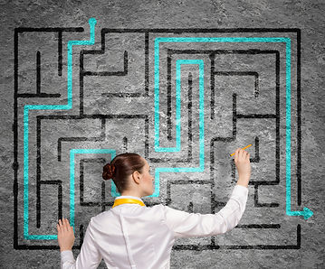 Woman drawing the route to success on a maze