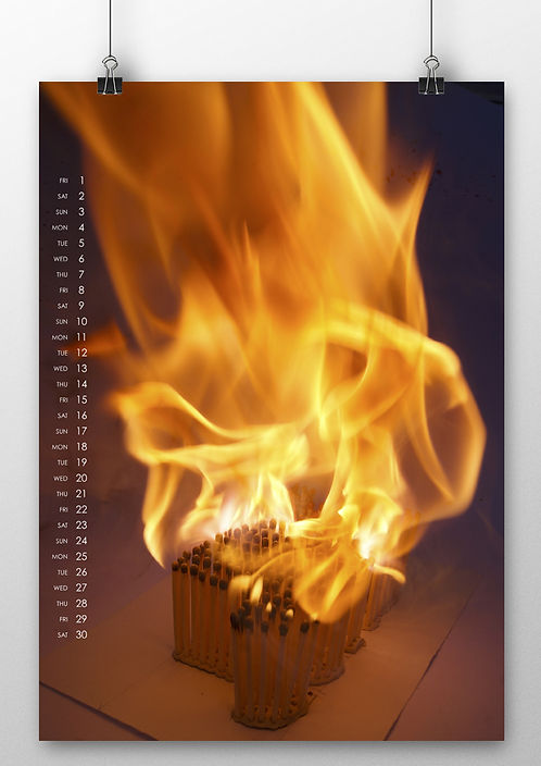 Photograph showing 3D typography made from matches ablaze.