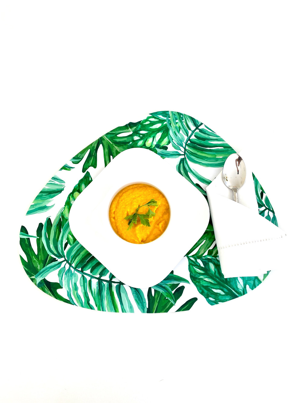 coconut ginger carrot soup, palm print table setting, palm leaf plate, tropical table setting