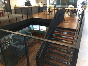 (2) Mid city Place feature staircase with mezzanine meeting room